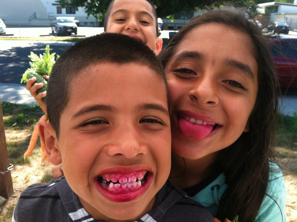 Jose and Maria show off their beet juice teeth.