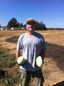 David Lewis holding two watermelons