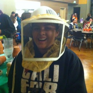 Student in bee keeper mask