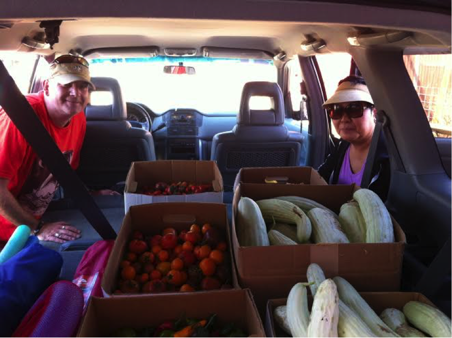 David Lewis and Kum Sun, two F2M employees, with their car loaded up with produce