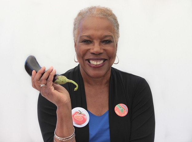 Audrey Rowe showing off one of her favorite summer vegetables