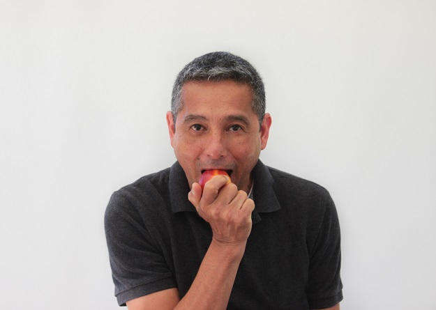 Jesus Mendoza enjoying a bite of fruit